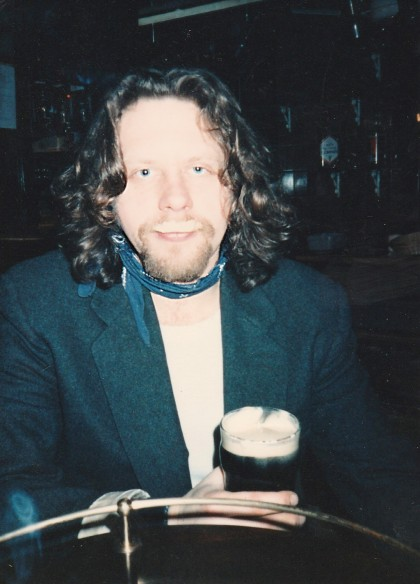 Al with beer moustache